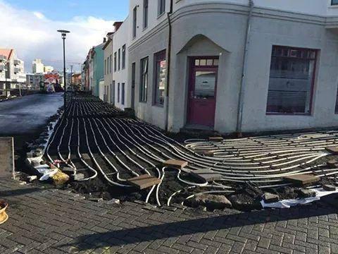 In Iceland and sidewalks have underfloor heating.