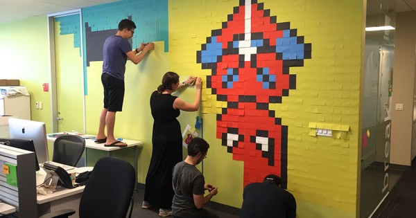 Worker Uses 8,024 Post-It Notes To Turn Office Walls Into Superhero Murals